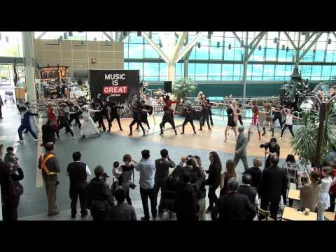 THE BRITISH BURST INTO YVR!  VANCOUVER AIRPORT FLASH MOB